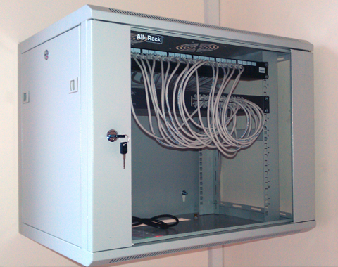 coms cabinet containing cat5e ethernet network installation in manufacturer industrial unit warehouse stevenage hertfordshire herts.png